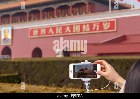 Photos being taken of Tiananmen Gate, the entrance to the imperial palace at the Forbiddan City in Beijing, China. - Stock Photo