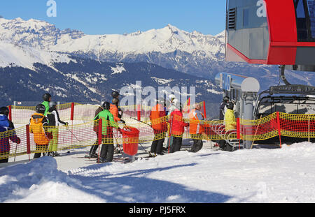 skier waiting in line for transport with lift - Stock Photo