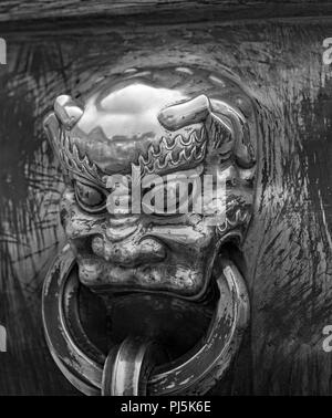 Cast metal Temple door knocker in Forbidden City Beijing China - Stock Photo