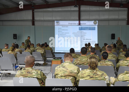 Lt. Col. Andrew Frankel (left), Deputy Air Reserve Component advisor and Col. Cory Reid (right), Senior ARC advisor, speak to Air Reserve and Air National Guard members deployed to the 407th Air Expeditionary Group at a town hall meeting at an undisclosed location in Southwest Asia, Aug. 24, 2018. Frankel and Reid met with ARC Airmen and 407th AEG leadership at all levels to make sure they had a complete understanding of what ARC Airmen bring to the fight and address any concerns ARC members may have while deployed. (U.S. Air Force photo by Staff Sgt. Dana J. Cable) - Stock Photo