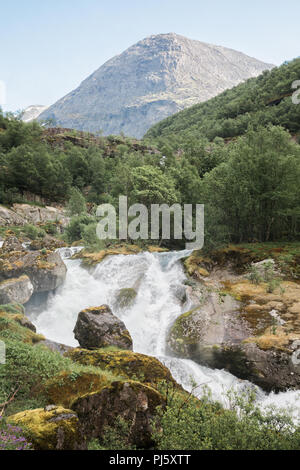 Waterfalls from the Briksdal glacier in Jostedalsbreen National Park, Norway - Stock Photo