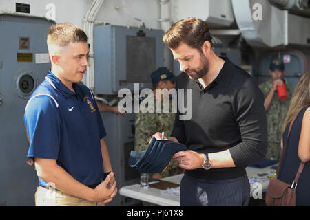 180831-N-JG119-2005 LOS ANGELES (Aug. 31, 2018) - Ship's Serviceman Seaman Cody Powell, a native of Chesterfield, South Carolina asks for an autograph from John Krasinski on board the Arleigh Burke-class guided missile destroyer USS Dewey(DDG105) during Los Angeles Fleet Week (LAFW). LAFW is an opportunity for the American public to meet their Navy, Marine Corps and Coast Guard teams and experience America's sea services. During Fleet Week, service members participate in various community service events, showcase capabilities and equipment to the community, and enjoy the hospitality of Los An - Stock Photo