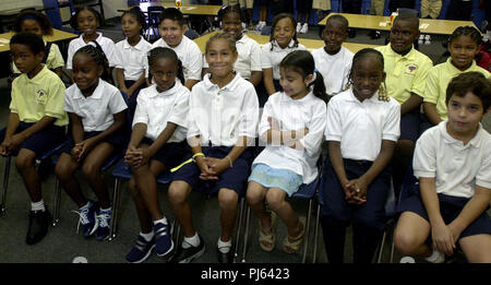 Sarasota, Florida, USA. 31st July, 2002. Almost 1 year after Sept 11, 2001, the former second grade class of Ms. Kay Daniels has a reunion. This was the class President George Bush was reading to when he heard about the attack on the twin towers. These are her past students going into the third grade. Picture taken July 31st, 2002. First Row, left to right, Lenard(cq) Rivers, 8, Raegina(cq) Washington, 8, Natalia Pinkney, 8, Tyler Radkey, 8, Chantal Guerrero, 7, Mariah Williams, 8, Lazaro Dubrocq(cq), 8, 2nd row (l-r), Cherish Mazon, 8, Krystal(cq) Davis, 9, Dinasty(cq) Brown, 8, Bryan Valadez Stock Photo