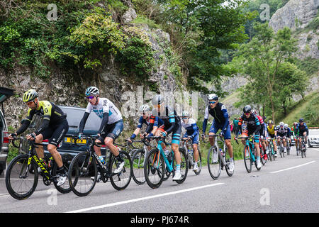 Cheddar Gorge, UK. 4th September, 2018. Cyclists taking part in The 2018 OVO Energy Tour of Britain ride through the Cheddar Gorge in Somerset. This was the third stage which started and finished in Bristol Credit: David Betteridge/Alamy Live News - Stock Photo