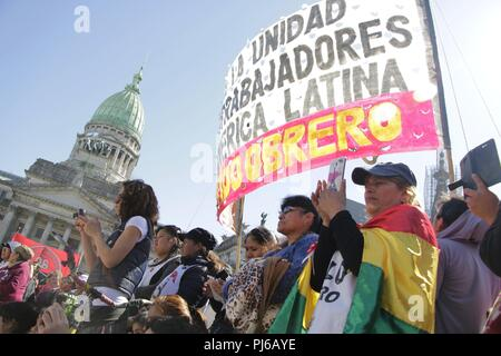 Buenos Aires, Federal, Argentina. 4th Sep, 2018. To the cry of ''Migrate is NOT Crime'' the Migrant Community of the City of Buenos Aires March to the Congress of the Argentine Nation on the Day of the Immigrant against the National Emergency Decree (DNU) 70/2017, against the adjustments, in favor of the rights of immigrants and for the recognition of the contributions made by immigrants in Argentina. Credit: Roberto Almeida Aveledo/ZUMA Wire/Alamy Live News - Stock Photo