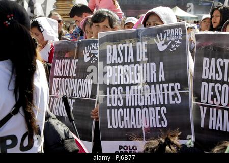 Buenos Aires, Federal Capital, Argentina. 4th Sep, 2018. To the cry of ''Migrate is NOT Crime'' the Migrant Community of the City of Buenos Aires March to the Congress of the Argentine Nation on the Day of the Immigrant against the National Emergency Decree (DNU) 70/2017, against the adjustments, in favor of the rights of immigrants and for the recognition of the contributions made by immigrants in Argentina. Credit: Roberto Almeida Aveledo/ZUMA Wire/Alamy Live News - Stock Photo