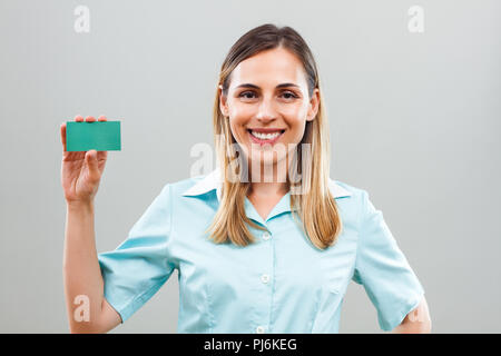 Portrait of beautiful showing business card. - Stock Photo
