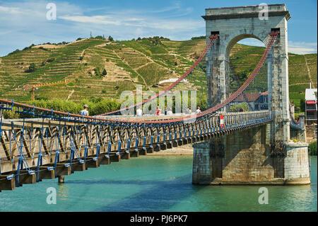 The historic suspension bridge built by Marc Seguin across the River Rhone linking Tournon sur Rhone, Ardeche  and Tain L'Hermitage, Drome. France. - Stock Photo