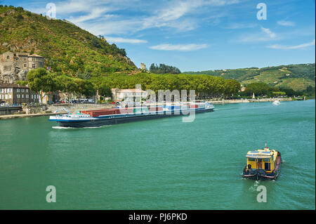 Boats on the River Rhone pass through Tournon sur Rhone in the Ardeche department, Rhone Alps region of France - Stock Photo