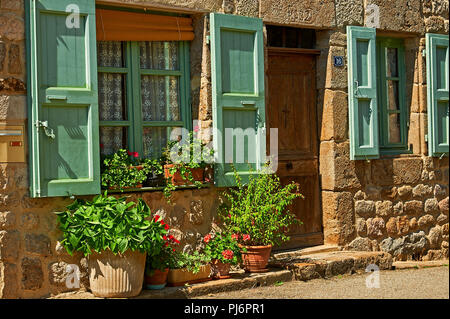 Saint Felicien, Ardeche department, Rhone Alps, France and a cottage front with windows and shutters - Stock Photo