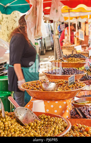 Market stall selling olives in the Ardeche town of Lamstre - Stock Photo