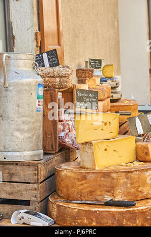Stall selling cheese at the weekly market in the town of Lamastre, Ardeche, Rhone Alps region of France - Stock Photo
