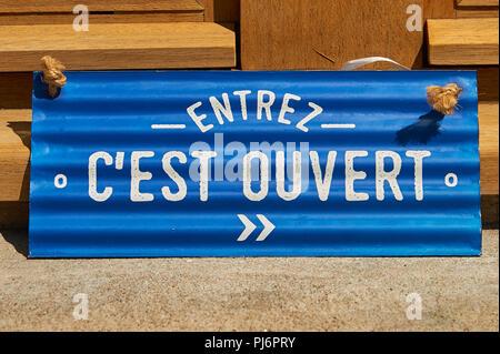 Sign in shop doorway, Saint Felicien,Ardeche,Rhone Alps,France - Stock Photo