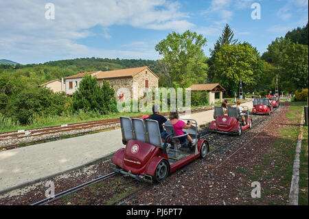 Tourists riding on the velorail between Lamastre and Boucieu-le-Roi in the Ardeche region, France. - Stock Photo