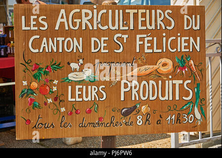 Saint Felicien Ardeche Rhone Alps France and a French language sign advertising a farmers market in the town. - Stock Photo