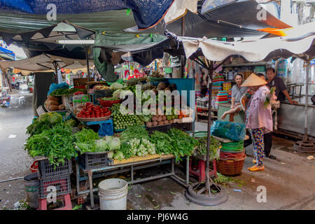 Ho Chi Minh City, Asia - May 12, 2018: Vegetables being sold in a local market in Saigon - Stock Photo
