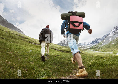Tourists at trekking route in mountains - Stock Photo