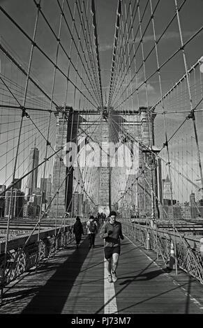 Jogger on the Brooklyn Bridge, New York City - Stock Photo