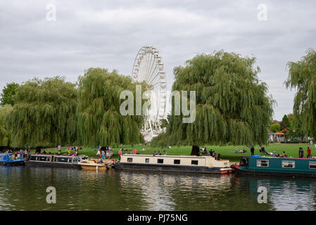 Ferris wheel and river Avon with canal barges, Stratford Upon Avon, Warwickshire, England. - Stock Photo