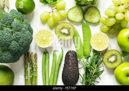 Health concept: top view of green fruits and vegetables: apples, pears, salad, broccoli, cucumber, asparagus, beans, manetouts, kiwi, grapes, avocado, - Stock Photo