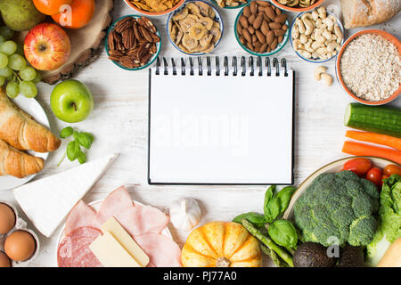 Variety of fruits and vegetables, nuts, cereals, ham, cheese on the white wooden table, top view, selecitve focus - Stock Photo
