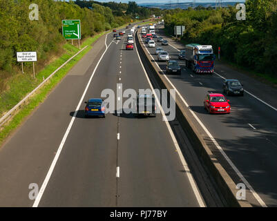 Cars and lorry in traffic on Edinburgh City dual carriageway bypass viewed from bridge overpass with road sign to Berwick Upon Tweed, Scotland, UK - Stock Photo