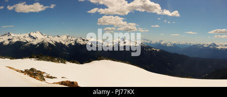 Snowy mountain trees with a view overlooking Blackcomb Mountain. - Stock Photo