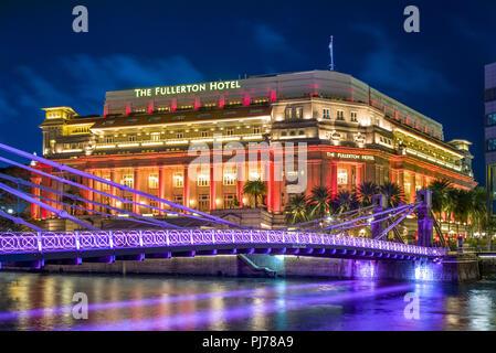 Singapore - August 8, 2018: The Fullerton Hotel Singapore is a five-star luxury hotel located near the mouth of the Singapore River - Stock Photo