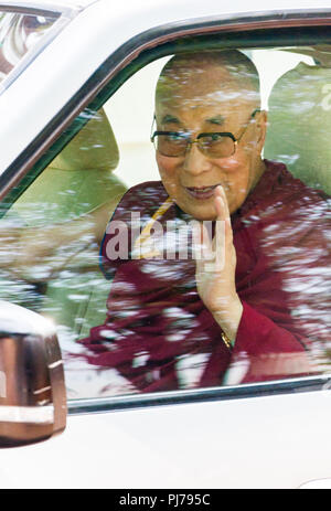 MUMBAI, INDIA – December 10 2017: The 14th Dalai Lama waves and blesses devotees as he leaves after giving a spritiual lecture at Somaiya college. - Stock Photo