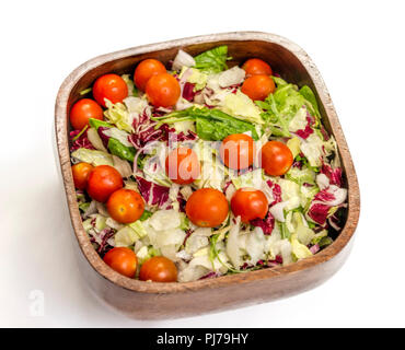 Fresh salad of lettuce and cherry tomatoes in wooden bowl on white background - Stock Photo