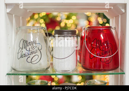 Three glass candle holders jars in the box, selective focus, with beautiful bokeh on the background - Stock Photo