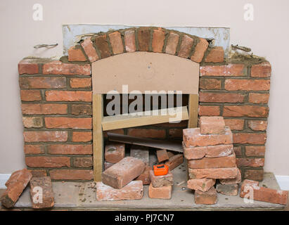 indoor diy project building fireplace in the house finishing touches selective focus stock. Black Bedroom Furniture Sets. Home Design Ideas