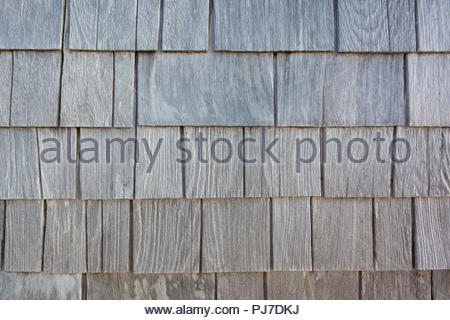 Weathered wood shingles on a coastal building. - Stock Photo