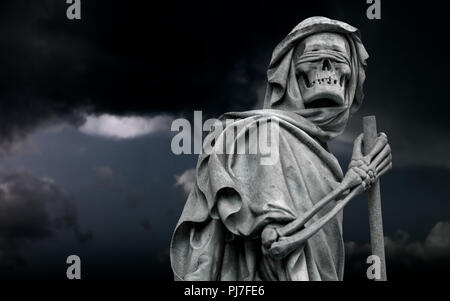 The blindfolded Grim Reaper wanders in the dark night - Stock Photo