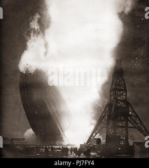 The Hindenburg disaster, May 6, 1937.  The German passenger airship LZ 129 Hindenburg caught fire and was destroyed whilst trying to dock with its mooring mast at the Naval Air Station Lakehurst,  Manchester Township, New Jersey, United States of America.  From These Tremendous Years, published 1938. - Stock Photo