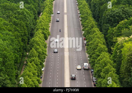 BERLIN, GERMANY - MAY 15 2018: Aerial view of cars passing crossroad under Victory Column in Tiergarten on May 15, 2018 in Berlin, Germany. - Stock Photo
