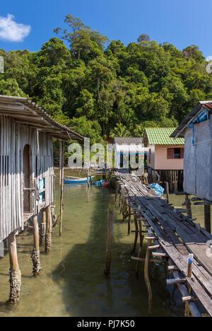 Stilt houses in Baan AoYai Salad port and fishing village on Koh Kood Island, Thailand - Stock Photo