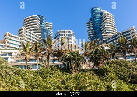 Beach ocean landscape with flat apartment buildings holiday lifestyle  coastline landscape. - Stock Photo