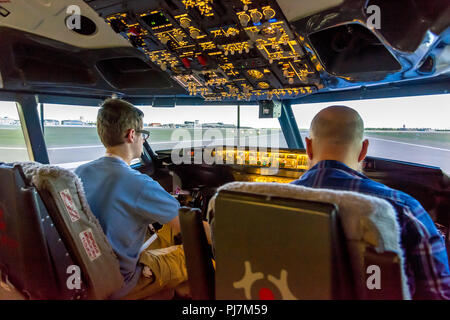 WARSAW, POLAND, August 5, 2017: Interior of modern flight simulator for the training of the pilots. - Stock Photo