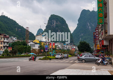 Street and the buildings of the tourist city of Yangshuo known for karst peaks in China - Stock Photo