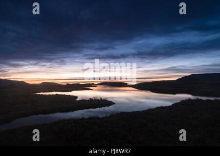 pre-dawn light on Llyn Y Caseg Fraith, Snowdonia, North Wales - Stock Photo