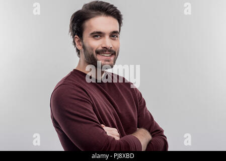 Image without face retouching with handsome bearded smiling man - Stock Photo
