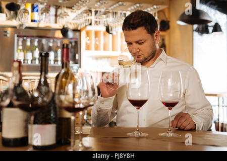 Nice smart man holding a glass of wine - Stock Photo