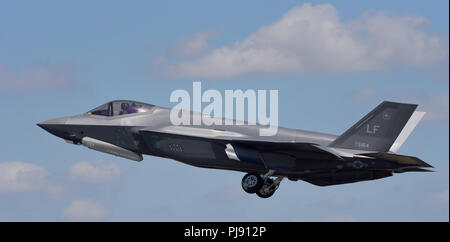 US Air Force Lockheed Martin F-35A Lightning II stealth fighter jet plane taking off at the Royal International Air Tattoo RIAT RAF Fairford airshow - Stock Photo