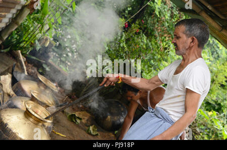 Traditional chef are cooking in the  Domestic Kitchen at Himachal Pradesh - Stock Photo