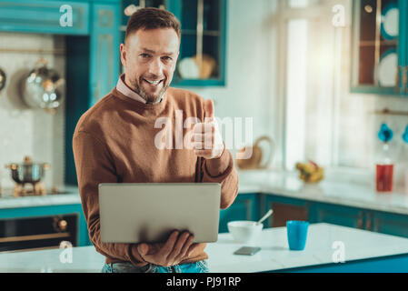 Pleasant man being in a good mood - Stock Photo