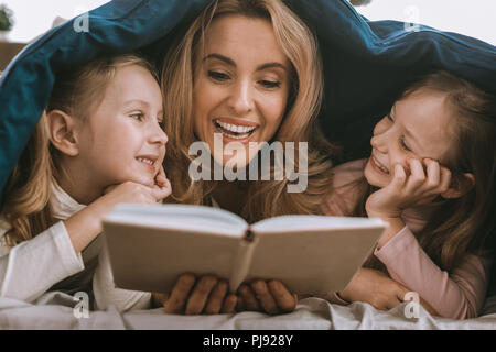 Positive happy woman reading a book - Stock Photo