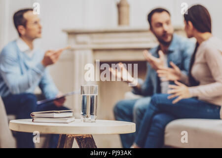 Glass of water standing on the table - Stock Photo