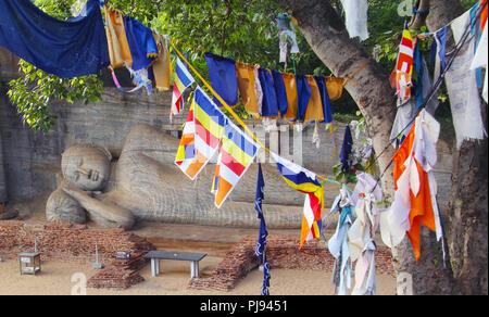 Giant reclining Buddha statue in Polonnaruwa,Sri Lanka - Stock Photo