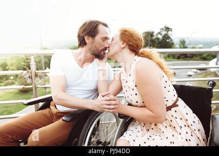 Harmonious mature couple kissing outdoors - Stock Photo
